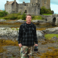 Food Over 50 director Jonathan White at Eilean Donan Castle in Scotland